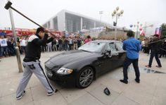 china men smash maserati quattroporte