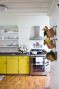 A Beautiful Mess Kitchen Tour. So cheery...and oh my gosh, the before was scary. I love it @Elyse Woodbury Pehrson Larson of A Beautiful Mess , great job! :)