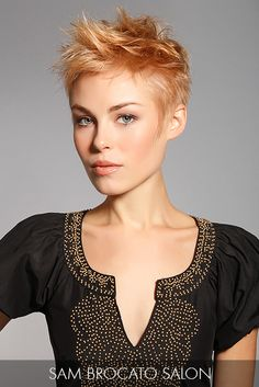 A layered pixie entices the eye with textured, strawberry-blonde strands that dance and sway to the rhythmic movement of the cut.
