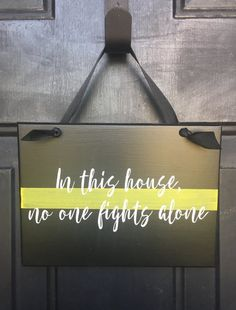 A personal favorite from my Etsy shop https://www.etsy.com/listing/471555305/in-this-house-no-one-fights-alone-thin