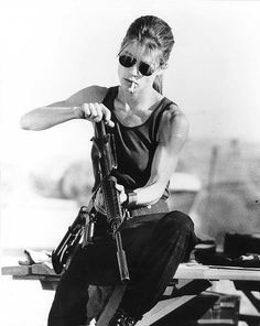 Sarah Connor from the second Terminator movie. She's the main character in the first movie so I could integrate her into the movie poster.