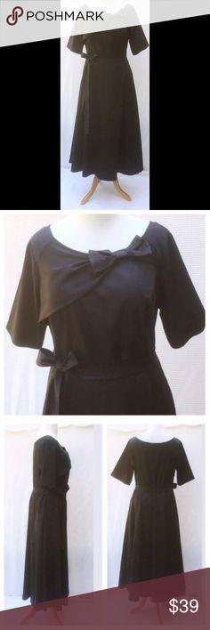 "New Eshakti Navy Fit & Flare Maxi Dress 22W New Eshakti Navy fit & flare midi dress Size 22W Measured flat: underarm to underarm: 47"" Waist: 40-46"" Length: 54 1/2"" Sleeve: 12"" Draped asymmetrical bodice panel w/ bow, princess seamed bodice, seamed waist w/ elastic back. Midi paneled flared skirt, side angled pockets, elbow length sleeves. Cotton/spandex, heavier mid-weight. Machine wash. New w/ cut out Eshakti tag to prevent returning to Eshakti. eshakti Dresses Maxi"