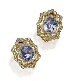 PAIR OF SAPPHIRE AND DIAMOND EARCLIPS, BUCCELLATI The cushion-shaped sapphires weighing approximately 8.00 carats, within delicately pieced mountings of yellow and white gold set with rose-cut diamonds, signed Buccellati, Italy, numbered W1824.