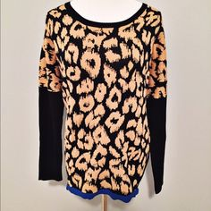 Animal print sweater Fun animal print sweater with bright blue hem from Neiman Marcus.  Dolman style sleeves.   Fits true to size.   New without tags.   Note: 20% off 3 or more items bundled from my closet Neiman Marcus Sweaters Crew & Scoop Necks