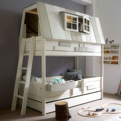 The Hang-Out Bed for boys features a top cabin with window, inner 2-step ladder, bottom bunk and pull out drawer. This drawer can be converted into a third tier guest bed. These beds are handmade to order and you will need to allow 6 weeks for delivery.  Read more http://www.studioaflo.com/inspirations/lovely-range-of-themed-childrens-beds-mixing-fun-play-and-rest/
