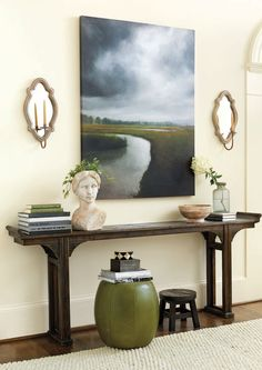 Our Storm Over the Marsh painting is one of our forever favorites, especially when paired with a pair of gold sconces and a long, narrow console table.