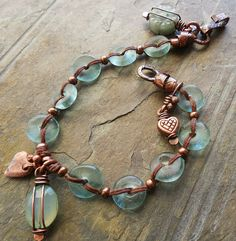 https://flic.kr/p/p3uUnn   DSCN5179   Recycled glass discs from Happy Mango Beads; Mykonos heart charm from Stinky Dog Beads.