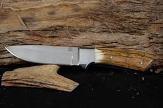 """Overall 9 3/8"""" with 4 1/2"""" blade.  Mammoth ivory scales handle with mirror finish. Made with 440C steel"""