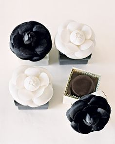Sweet treats make elegant favors in when placed in black and white flower boxes