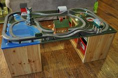 """Home made thomas train table with ikea storage bins as legs. - Home made thomas train table with ikea storage bins as legs…Brilliant…we are in the process of making one for Easton from """"Santa Claus"""" Ikea Storage Bins, Storage Units, Playroom Storage, Shelving Units, Ikea Shelves, Lego Storage, Storage Boxes, Toy Shelves, Table Storage"""