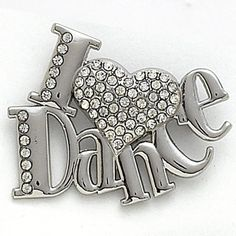 "Who doesn't love dance? This pins slightly larger design makes it perfect for pinning on bags or any outfit. Measures approximately 2""x2.25"""