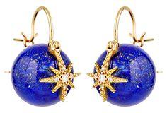 Diamond, lapis lazuli and 14 karat gold star earrings.