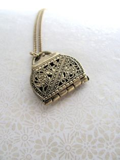 Movable purse locket necklace on long by MySoCalledVintage on Etsy, $26.00