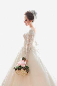 Long-sleeved wedding dress with veil | The Wedding - Arbert & Karina by Fery Saputra | http://www.bridestory.com/fery-saputra/projects/the-wedding-arbert-karina