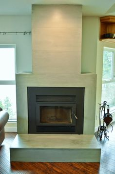 Contemporary Tiled Concrete Fireplace - Large Format Ultra-Thin Wall Tiles made in Canada Concrete Fireplace, Home Fireplace, Concrete Tiles, Fireplace Ideas, Fireplaces, Cement, Contemporary Tile, Tile Patterns, Wall Tiles