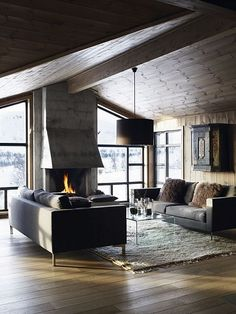 Cozy rustic modern cottage. Love that fireplace!