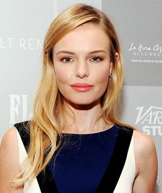 Kate Bosworth rocks long layers, a side part, and lightly curled ends.