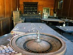 Bodie, California ghost town. Old gambling hall or saloon with the bar, player piano, and roulette wheel. I love that the chips are still stacked!