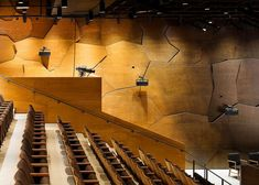 Overlapping plywood plates give the walls of Frank Gehry's Signature Center a textured surface designed to enhance the acoustics of the room.