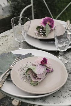 Intimate table setting. The flowers are lovely