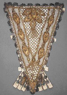 Stomacher, France, 1700-1750. Silk satin with metallic-thread lace, appliqués, passementerie and tassels.