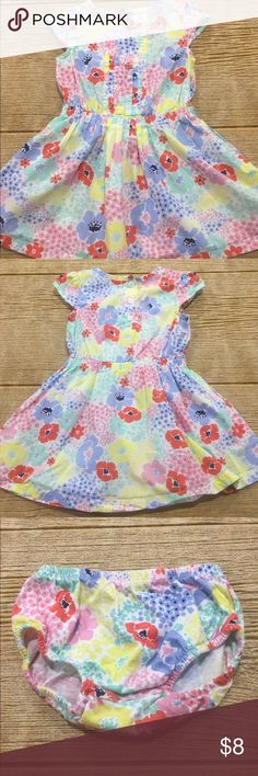 Carter's Floral Dress Light and airy summer dress with pleating down the front and pockets on each side. Matching bloomers in size 18M included. Carter's Dresses Casual