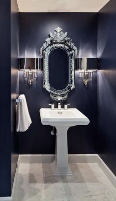 Doing this in the powder room! - Chic blue bathroom with navy blue paint color, Global Views Hardwired Nickel Torch Sconces flanking Venetian mirror and white pedestal sink. - Decoration for House Bathroom Inspiration, Bathroom Ideas, Bathroom Wall, Navy Bathroom, Bathroom Lighting, Silver Bathroom, Gothic Bathroom, Vanity Lighting, Bathroom Furniture