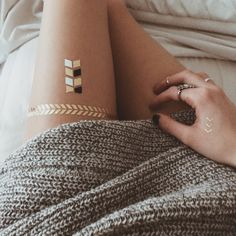 knit sweater + metallic tattoos Metallic glitter body art and tattoos now available at http://www.temporarytattoostore.co.uk/