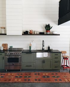 Olive green cabinets and a shiplap-covered range hood FTW, from Jenny Komenda at… – Home Renovation Green Kitchen Cabinets, Painting Kitchen Cabinets, Kitchen Countertops, Kitchen Decor, White Cabinets, Kitchen Ideas, Green Countertops, Soapstone Counters, 10x10 Kitchen