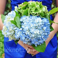 Hydrangea Bridesmaid Bouquet against darker (horizon) blue dress