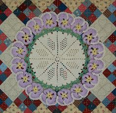 Crochet pansy doily. Free pattern is here: http://web.archive.org/web/20070824234331/http://www.countryyarns.com/pansy.htm