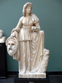 Roman statue of Melpomene, 2nd century AD. The muse is shown in a long-sleeved garment with a high belt, clothing that was associated with tragic actors. Her wreath of vines and grapes alludes to Dionysus, the god of the theatre.