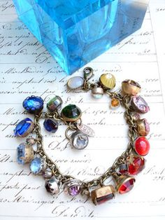 Color Wheel Vintage Colored Rhinestone Button Bracelet #6 This bracelet has all vintage rhinestone buttons in various colors and I lined them up like the color wheel, starting from white and moving through yellow, pink, red, purples, blues, aquas and greens! There are so many different varieties and sizes, some with lacy bezels, some with...