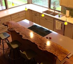 A wooden countertop completed by Greenwood Bay makes an elegant statement in this kitchen. #luxeHouston