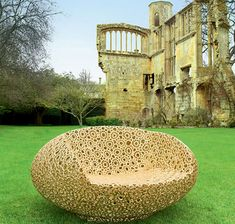 """just stunning """"Bon Bon Gold"""" by Dutch designer Marcel Wanders. It's a hollow chair made of crocheted rope that holds its form due to heavy coatings of resin and gold."""