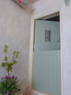Farrow and ball limewashed courtyard with Farrow and Ball Litchen stable door.