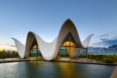 Steyn Studio's chapel frames dramatic views of South African countryside below its sinuous roof. A bright canopy white undulates above the glazed walls of this chapel outside Cape Town, framing views right through it to scenic surroundings Sacred Architecture, Religious Architecture, Contemporary Architecture, Architecture Design, Parametric Architecture, Innovative Architecture, Church Architecture, Colonial Architecture, Amazing Architecture