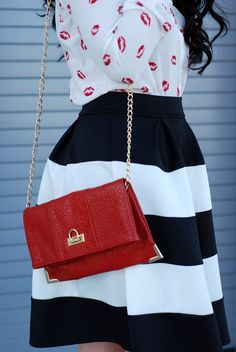Lips shirt with striped skirt, leopard heels, red lips, and red bag for a Valentines Day Outfit. Outfit from The Red Closet Diary Blog. #fashionblogger #fashion