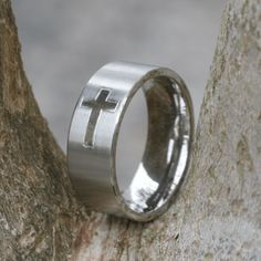 www.Caratcorp.com- Men's wedding band with Christian cross and brushed finish.