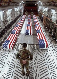 The saddest use for the American Flag - draped over the coffins of our soldiers.