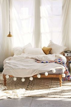 Plum & Bow Alia Duvet Cover by Urban Outfitters. Love love the pom pom trim. Such a beautiful texture to create a cosy bedroom.