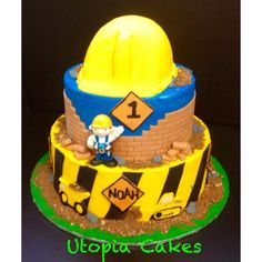 a construction themed cake for a little man, hard hat is a smash cake iced with buttercream