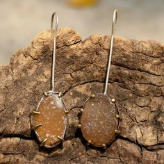 Light orange druzy earrings on silver pole with sterling silver backing