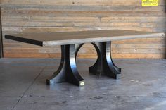 Double Liberty base dining table with reclaimed boxcar oak top, by Vintage Industrial in Phoenix...