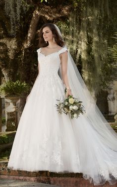 This Essense of Australia lace and tulle over satin A-line #bridalgown is an instant classic with its cap sleeves, hand-sewn Diamante accents, and chapel train.