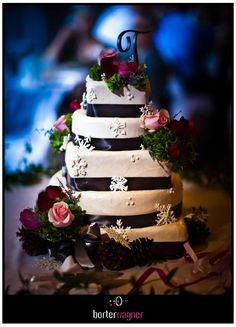 classic white wedding cake, decorated with pink and red roses.    borterwagner photography    borterwagner.com