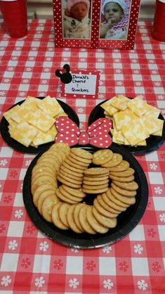 Donald's cheese and quackers minnie mouse party Two small plates, 1 larger plate (dollar tree) lots of scotch tape and cardstock red with white polka dots (found at ac moore craft store) print of outline online and cut bow out and trace on cardstock at your touches with a black sharpy. Easy peasy!
