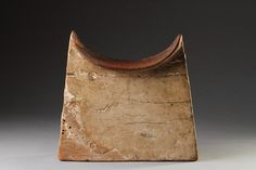 Headrest from Ancient Egypt | Cedar Wood and Gesso | 2663 BC to 2195 BC  .