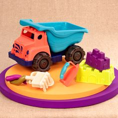 Build the tallest castles with these beach tools. Rake and shovel with groovy grips. Large dump truck. 2 castle molds. Smoother.