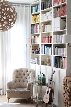 Love this room.  Comfy chair, books and a guitar nearby.  What could be better?